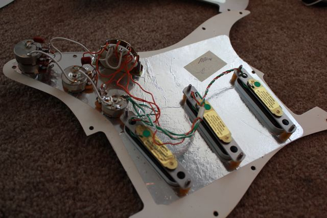 http://xhefriguitars.com/Parts/Plus_Parts_Electronics/94PG_ASS.jpg