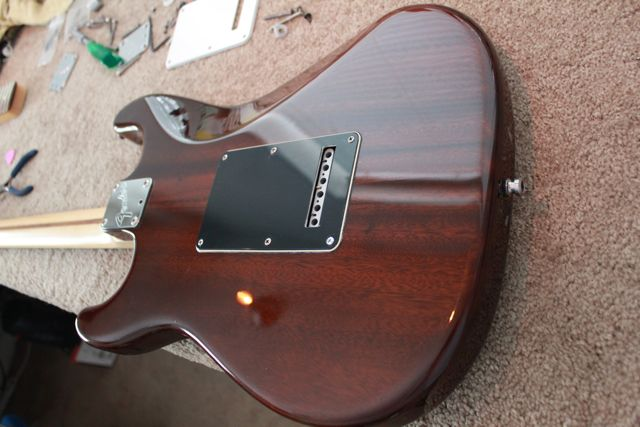 http://xhefriguitars.com/Stuff/FlameCustomBuild2011/Build%201%20Finish/ULTRA%20FINISHED2.jpg
