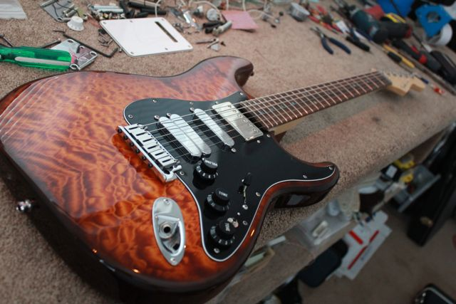 http://xhefriguitars.com/Stuff/FlameCustomBuild2011/Build%201%20Finish/ULTRA%20FINISHED6.jpg
