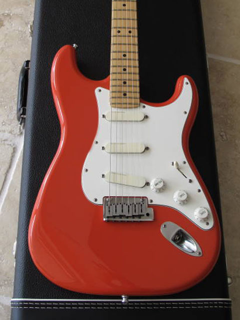 http://xhefriguitars.com/Stuff/Plus%20Colors/Fiesta%20Red.jpg