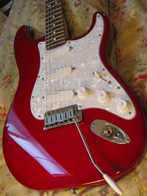 http://xhefriguitars.com/Stuff/Plus%20Colors/Lipstick%20Red%20Burst.jpg