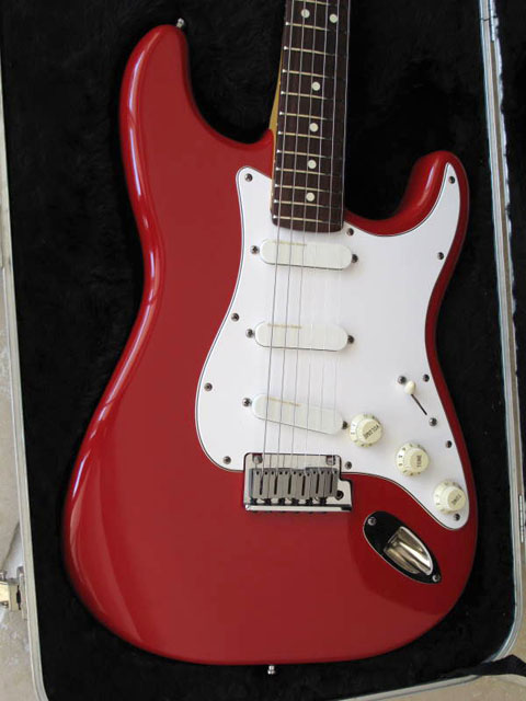http://xhefriguitars.com/Stuff/Plus%20Colors/Torino%20Red.jpg